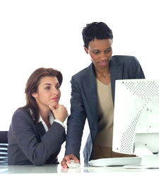 Two business women working on a computer